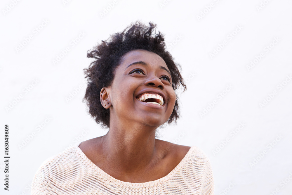 Fototapeta Young black woman looking up and laughing