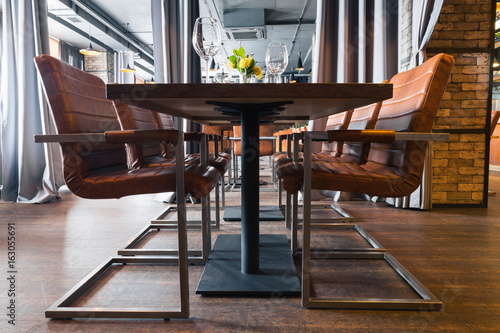 Enjoyable Black Shiny Steel Leather Chairs And Wooden Tables In Indoor Gmtry Best Dining Table And Chair Ideas Images Gmtryco