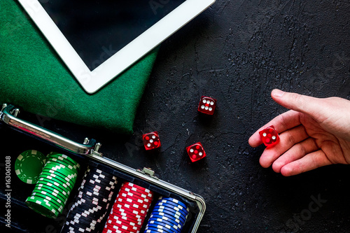 Hand is rolling the dice плакат