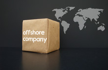 Offshore Companies Around The World. On The Box An Offshore Company Is Written. In The Background A World Map.