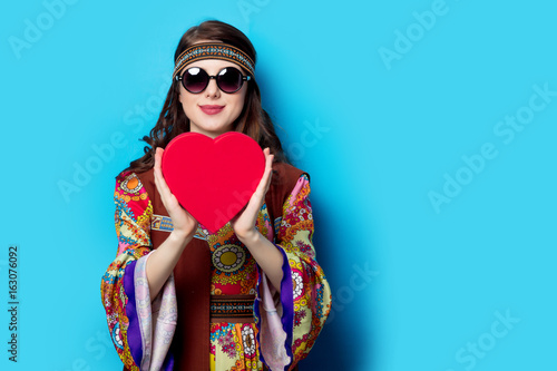 Fotografie, Obraz  Portrait of Young hippie girl with heart shape box