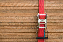 Red Ratchet Strap Fixing Wood Boards / Wooden Planks