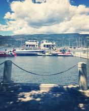 Boats And Jet Skis Docked At Marina