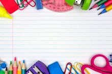 Colorful School Supplies Double Border Over A Lined Paper Background