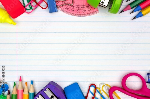 Fotografía Colorful school supplies double border over a lined paper background
