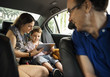 Son and Mom Using Tablet on the Car