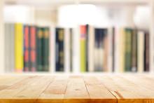 Wood Table Top On Blur Bookshelf Background