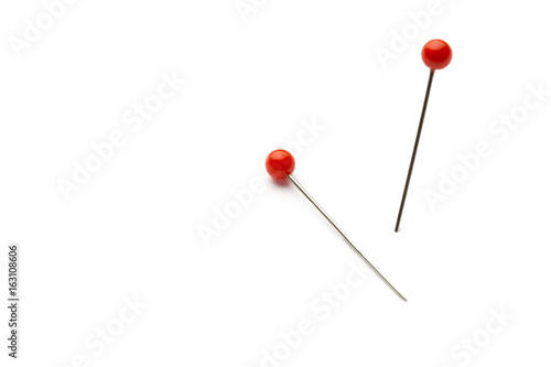 Stampa su Tela  Push pins isolated on white background.