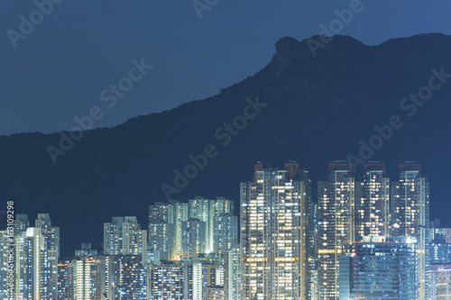 residential building under lion rock in Hong Kong city at night Poster
