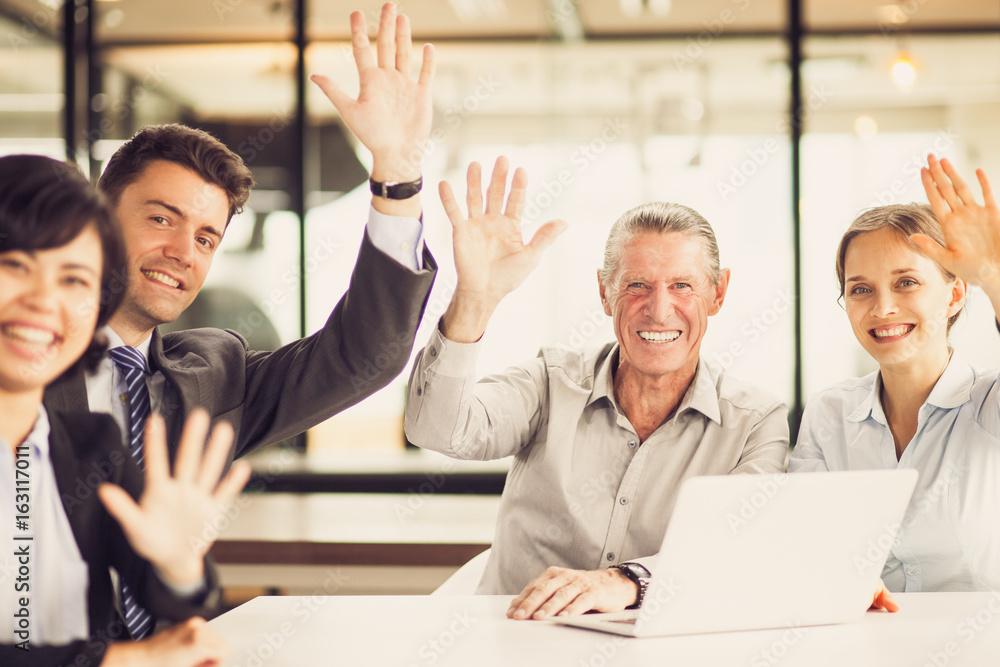 Fototapety, obrazy: Successful multiethnic team waving at camera
