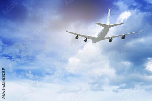 Türaufkleber Flugzeug Commercial airplane flying above blue sky and clouds. close up airplane flying or landing. traveling tour with airline concept. commercial plane or logistic concept. filtered image
