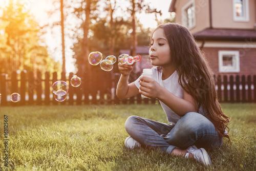 Little girl on backyard Wallpaper Mural