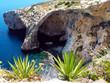 Malta Blue Grotto cave and cliff sea view. Mediterranean sea famous olace on Malta island.