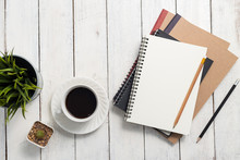 Empty Notebook And Coffee On  Wooden Table