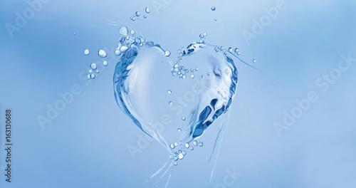 Fototapeta A heart made of water floating in blue water.