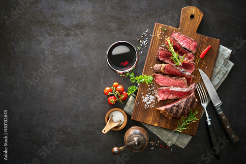 Keuken foto achterwand Steakhouse Sliced medium rare grilled beef ribeye steak