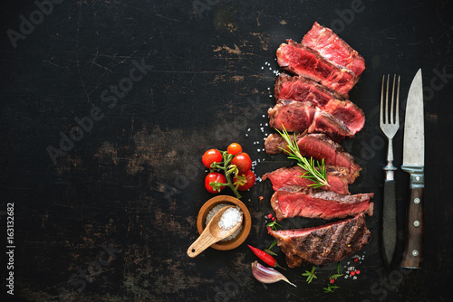 Aluminium Prints Grill / Barbecue Sliced medium rare grilled beef ribeye steak
