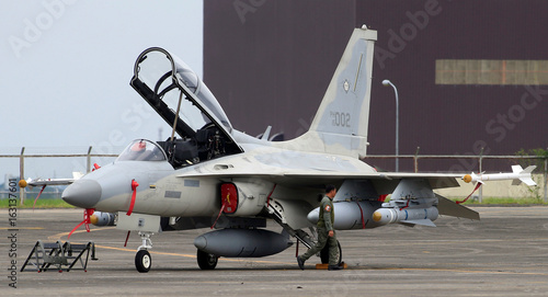 A pilot walks past a FA-50 fighter jet during the 70th Philippine
