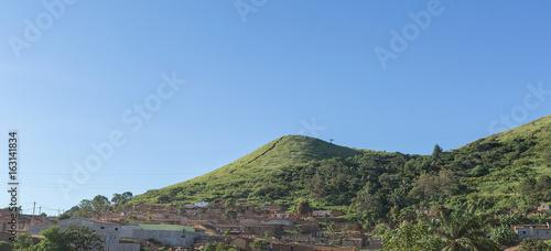 Printed kitchen splashbacks Khaki Rural village in angola, houses on hill, full of vegetation.