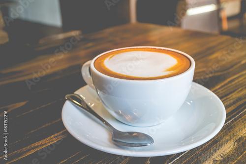 Fotografie, Obraz  hot coffee mocha with foam milk in vintage cafe(vintage effect)