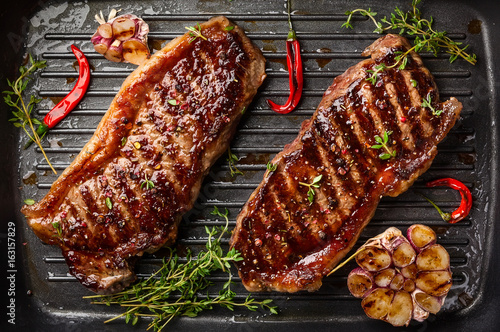 Aluminium Prints Steakhouse Grilled strip steak with spices