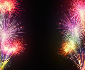 Fireworks explosions on black background