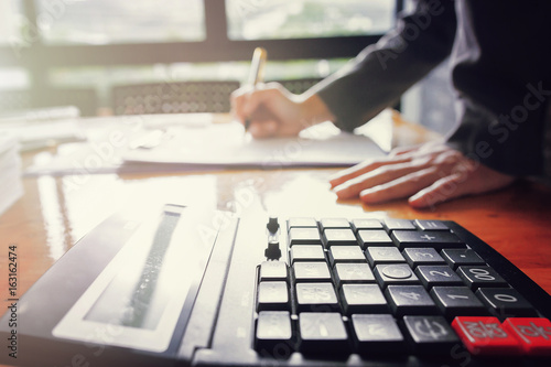 Fototapety, obrazy: Administrator business man financial inspector and secretary making report, calculating or checking balance.