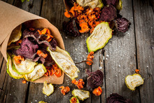 Organic Diet Food. The Vegan Diet. Dried Vegetables. Homemade Chips From Beets, Carrots And Zucchini. On Old Wooden Rustic Table, With Fresh Vegetables. Copy Space