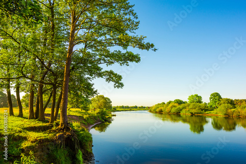 Garden Poster Blue Beautiful landscape with river, trees and meadows