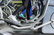 Close up view on legs of people exercising on the crosstrainer machines