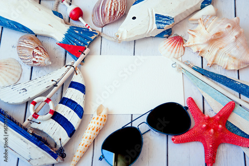 Foto auf AluDibond Schmetterlinge im Grunge Summer holiday background. Sea card with ship, sand, shells and starfish on white background top view. Vacation season. Copy space