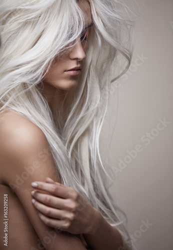 Photo Stands Artist KB Pretty nude lady with a lush coiffure