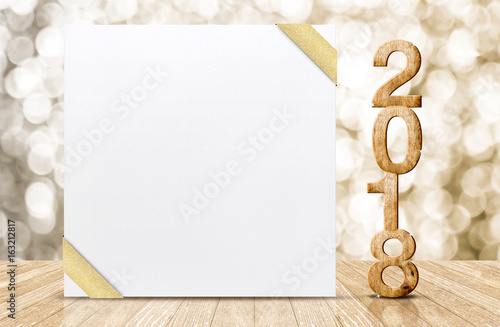 Photo  Happy new year 2018 with blank white greeting card with gold ribbon in perspecti
