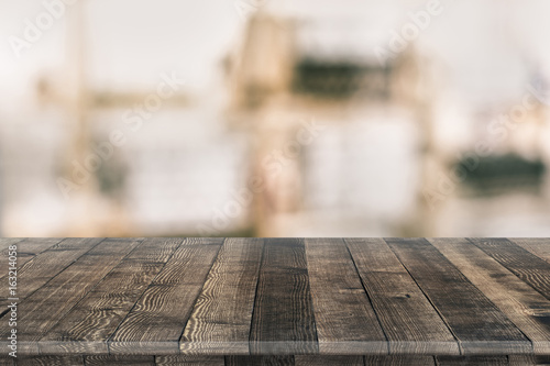 Poster Bois Empty wooden table for product placement or montage with focus to table top in the foreground, with white background. Wooden board empty table perspective.