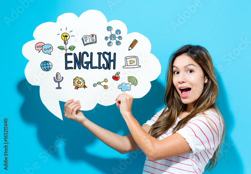 English text with young woman holding a speech bubble on a blue background Fototapeta