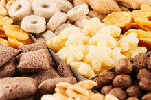 Corn Flakes Collection On Different Cereals Closeup, Decorative Background.