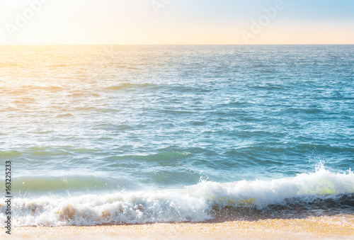 Fotobehang Zee / Oceaan Seafoam on the coast with water surface on the background