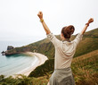 healthy woman rejoicing in front of ocean view landscape