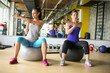 Young woman workout in healthy club. Young woman on Pilates ball.