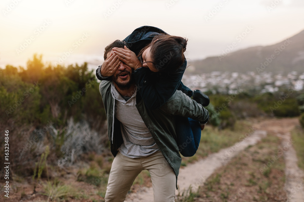 Fototapety, obrazy: Playful young couple enjoying themselves in countryside