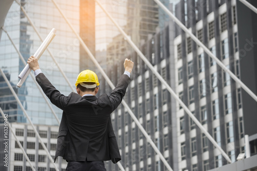 Professional construction engineer manager wear safety yellow helmet professional construction engineer manager wear safety yellow helmet holding blueprint feeling success after complete building project malvernweather