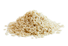 Heap Of Decorticated Sesame Seeds Isolated On White.