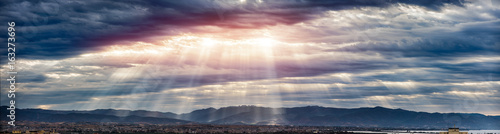 Obraz Beam of light through the clouds on the mountains - Rays of light shining through dark clouds , dramatic sky with cloud - fototapety do salonu