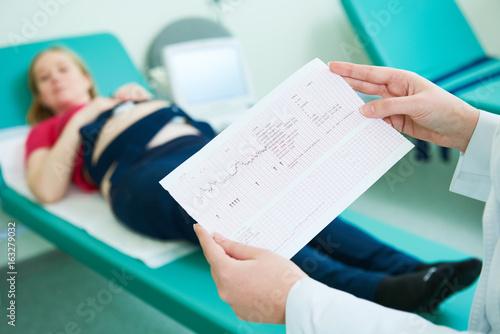 Pregnancy care. cardiotocography fetal heartbeat examination Canvas Print