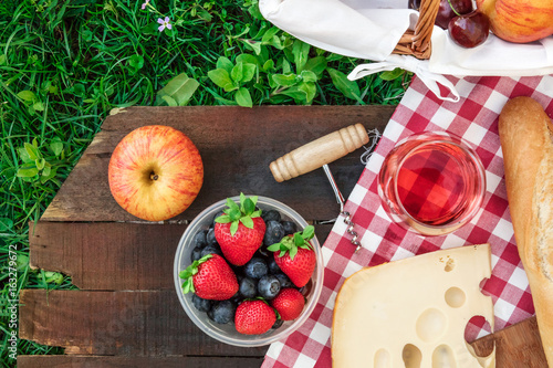 Keuken foto achterwand Picknick Picnic food and rose wine on wooden board with copyspace
