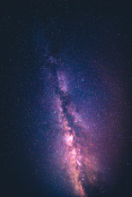 Starry Night Sky With The Milky Way, Galactic Centre On Bottom Right. Purple Orange And Blue