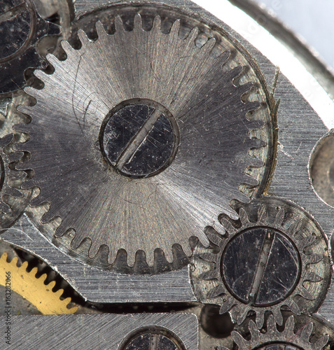 Photo The mechanism of the old clock on a large scale