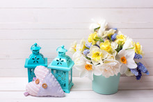 Muscaries And Yellow Narcissus Flowers In Vase, Heart  And Two Lanterns  On  Wooden Background.