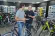 Two men in discussion in bicycle shop