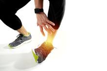 Runner Sportsman Holding Ankle...